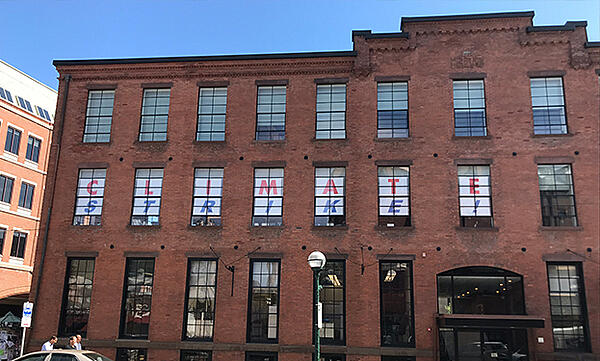 60-foot Climate Strike sign in our windows.